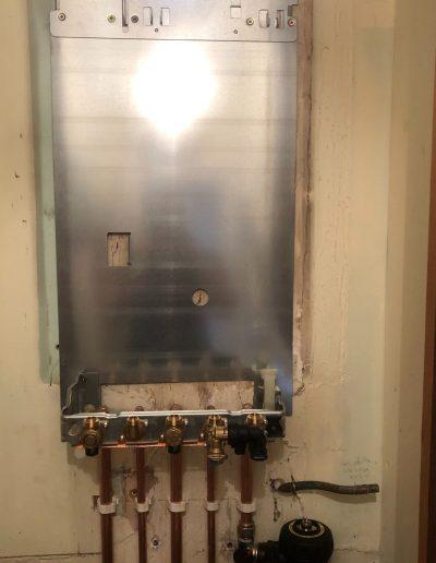Boiler Gallery - Boiler backing plate ready for new boiler - Freeflow heating and plumbing