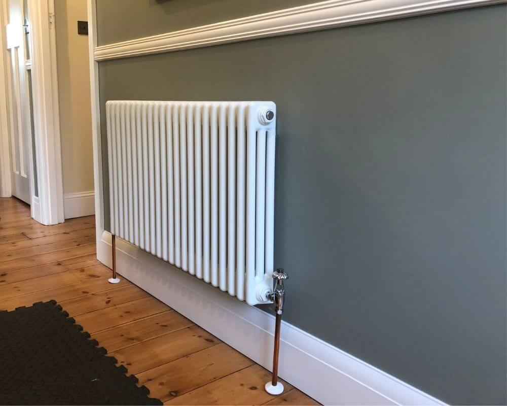 Central Heating Installation Plymouth - Radiator in hallway - Freeflow Plumbing and Heating