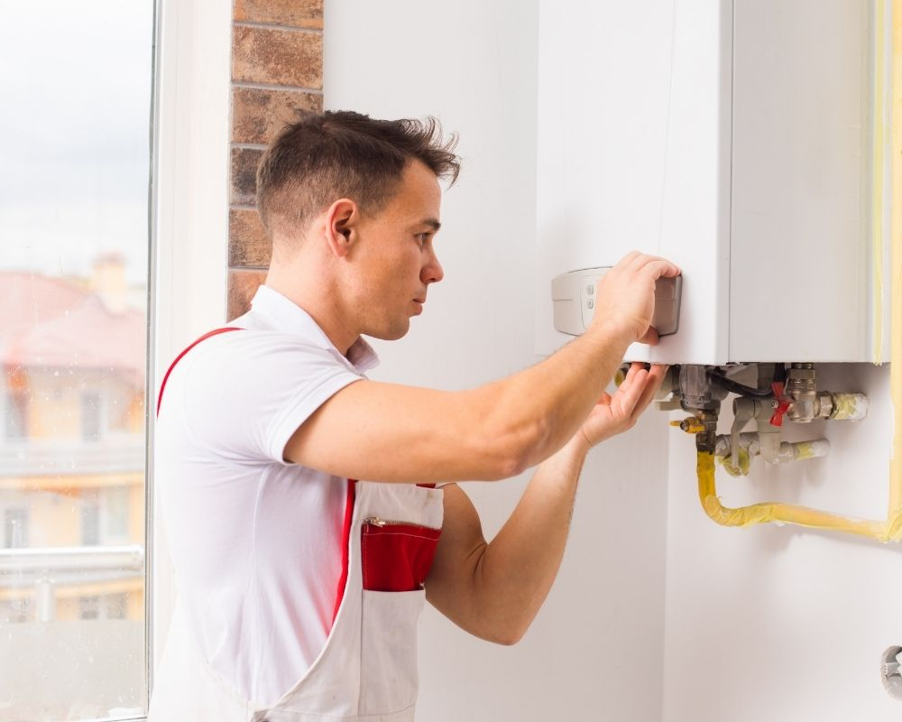 Gas Boilers Plymouth - Plumber servicing a boiler - Freeflow Plumbing and Heating