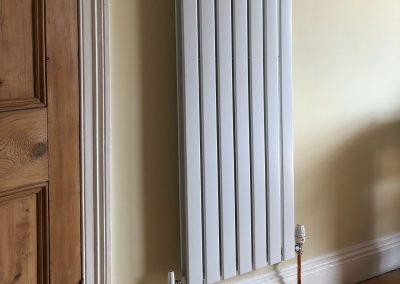 Heating and plumbing gallery - Tall flat white radiator - Freeflow heating and plumbing