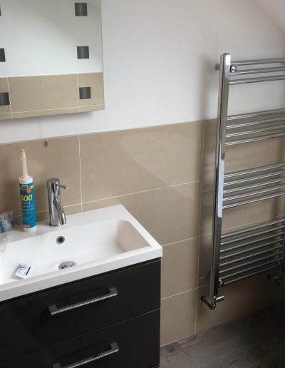 Kitchen and Bathroom Installations gallery - modern bathroom with towel rack and square sink - Freeflow heating and plumbing