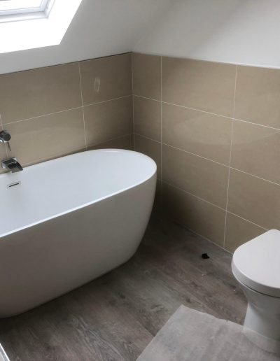 Kitchen and Bathroom Installations gallery - modern smooth finish bathtub and toilet - Freeflow heating and plumbing