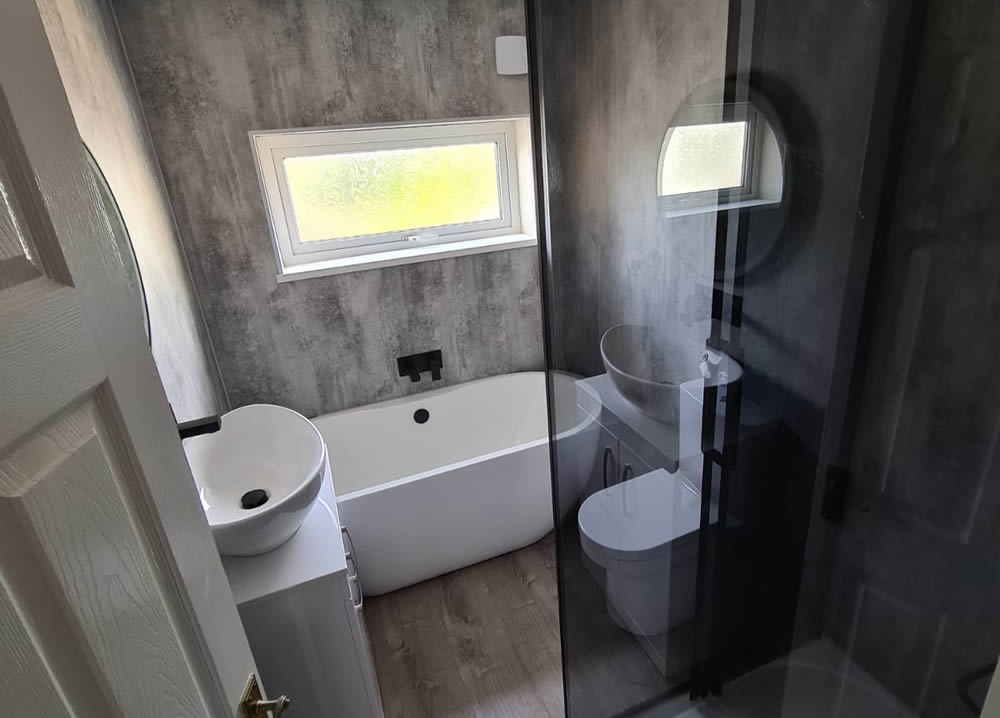about us - bathroom newly installed with window - freeflow plumbing