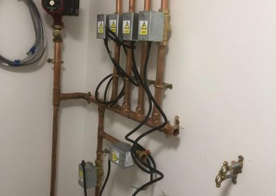 freeflow plumbing on site gallery - newly fitted pipes and cables ready for boiler to be installed - Freeflow heating and plumbing